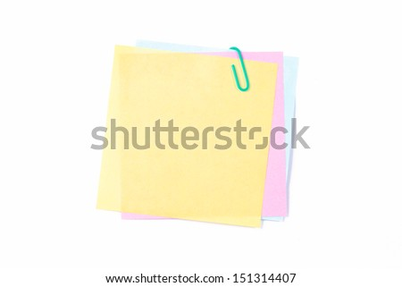 Paper clip on colorful sticky post it notes, isolated on white background.