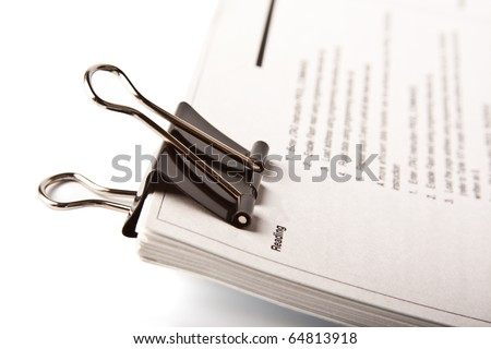 Paper clip on stack of paper - stock photo