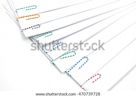 Paper clips and file on white  background