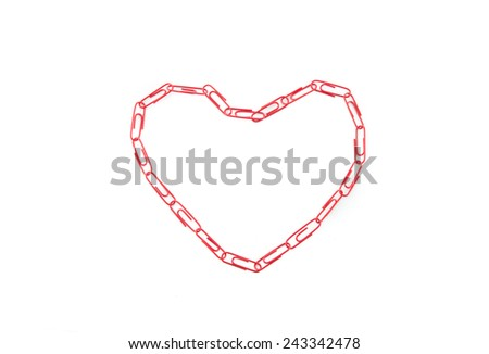 paper clips arranged in heart shape on white background. - stock photo