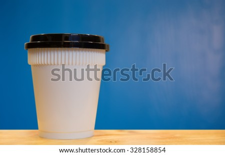 paper coffee cups of wood background blue - stock photo