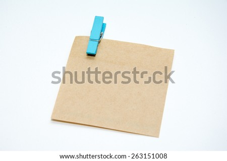 Paper color wood clip note on isolated white background.