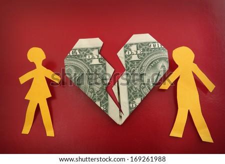 paper couple on broken dollar heart                                 - stock photo
