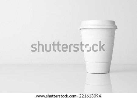 Paper cup with cap - stock photo