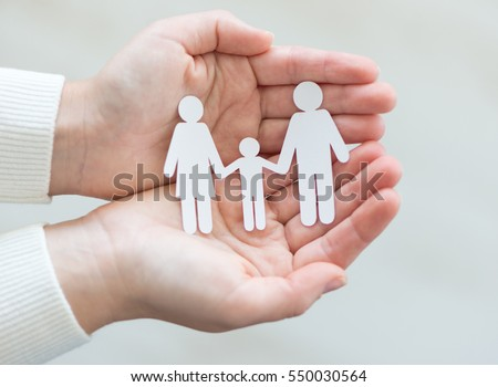 Paper cut family in hands