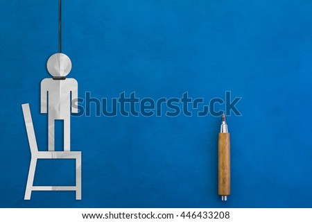 paper cut figure of human hanging with blue background depressed man concept - stock photo