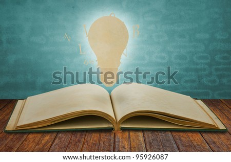 Paper cut of book of light bulb