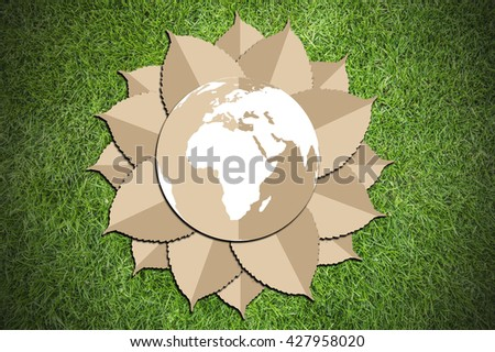 Paper cut of eco on green grass background - stock photo