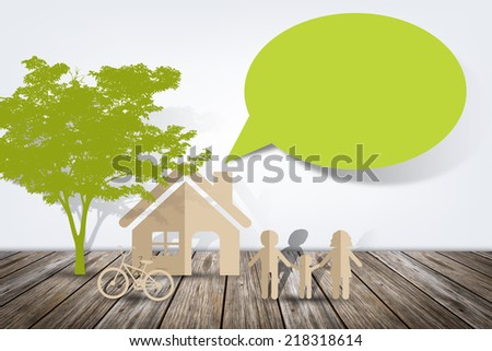 Paper cut of family on wooden floor - stock photo