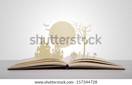 Paper cut of halloween on old book