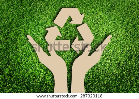 Paper cut of Reuse, Reduce, Recycle concept on green grass
