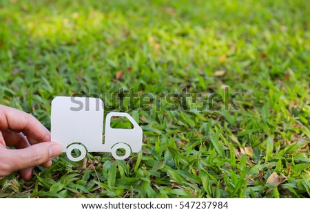 Paper cut of truck on green grass