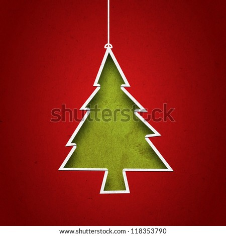 Paper cut to form christmas tree on  green grunge background - stock photo