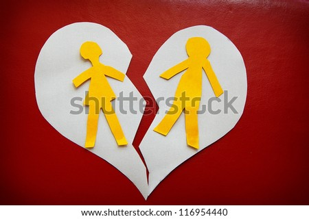 paper cutout couple on a torn heart -  divorce concept - stock photo