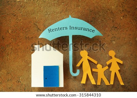 Paper cutout family with house under Renters Insurance umbrella                                - stock photo