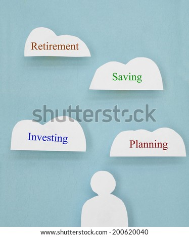 Paper cutout figure with financial related cloud text                                - stock photo