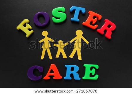 Paper cutout people with Foster Care letters                                - stock photo