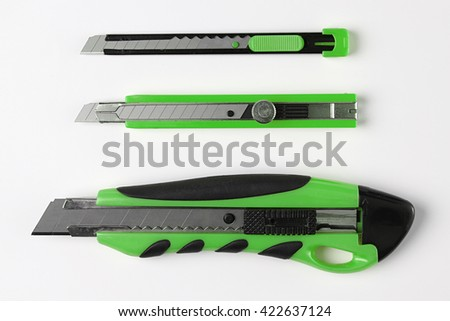 Paper Cutter isolated on White Background. Top View of Green Box Cutter Set With Real Shadow. School or Office. Copy Space for Text or Image. - stock photo