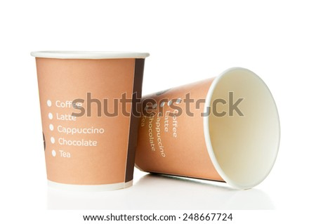 Paper disposable cups on white background. Back focus. - stock photo