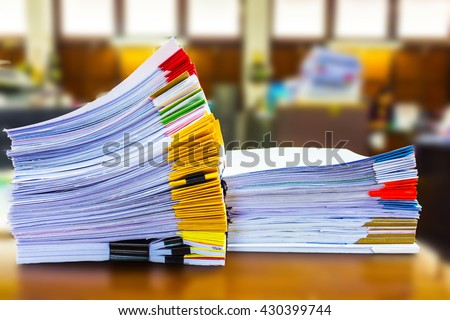 Paper documents stacked in archive - stock photo
