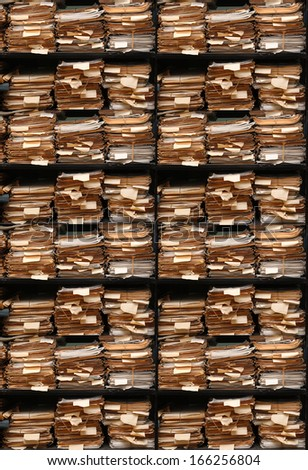 Paper documents stacked in archive multi version - stock photo