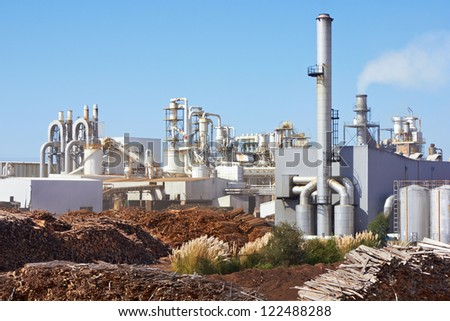 Paper Factory against blue sky - stock photo