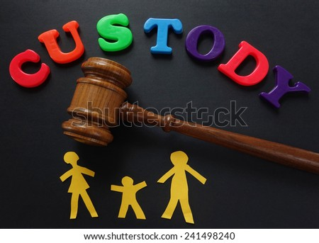 Paper family and gavel with Custody in play letters                                - stock photo