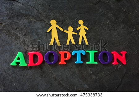 Paper family of three with Adoption play letters
