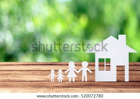 Paper family on wooden table with garden bokeh outdoor theme background