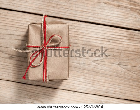 paper gift box with bow on wooden background