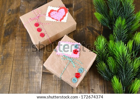 Paper gift boxes on wooden background