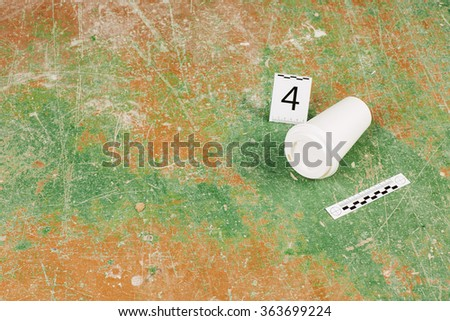 paper glass at the murder scene - stock photo