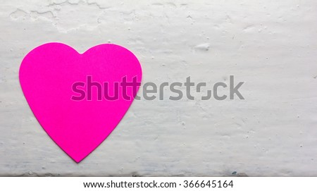 paper heart magenta colors against the white painted surface. Copy space. Free space for text, Close-up, top view - stock photo