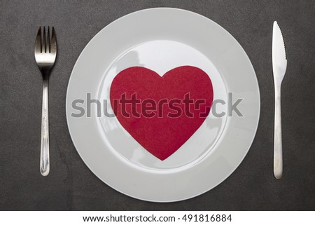 paper heart on a plate