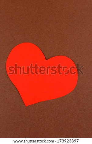 Paper heart on brown background