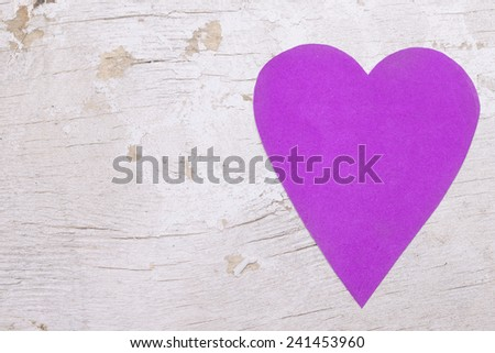 Paper heart on white wooden background - stock photo