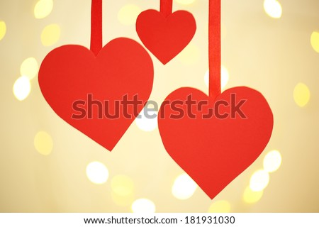 Paper hearts on bright background - stock photo