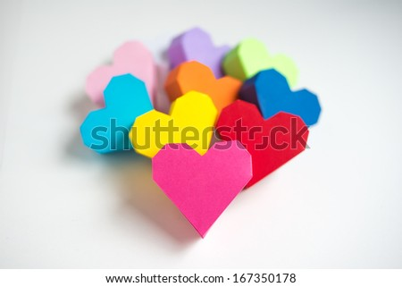 Paper hearts on white background - stock photo