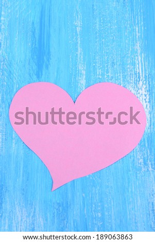 Paper hearts on wooden  background