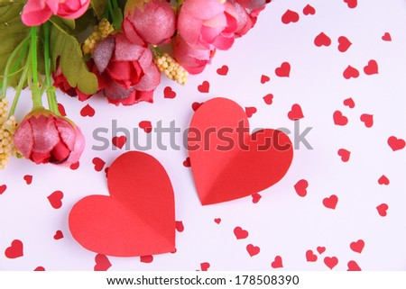 Paper hearts with flowers on bright background - stock photo