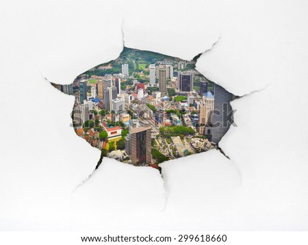 Paper hole and town (Kuala Lumpur Malaysia) - architecture concept - stock photo