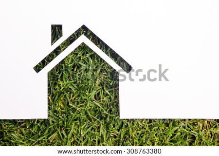 Paper house against green background. Real Estate Concept - stock photo