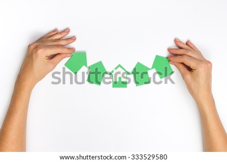 Paper house figure and blank business card on wooden background. Real Estate Concept. Top view. - stock photo