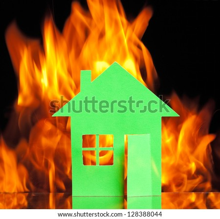 Paper house in fire on a black background concept - stock photo