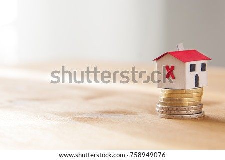 stock-photo-paper-house-on-a-coin-pile-m