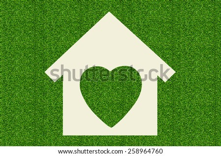 paper house on green grass background - stock photo