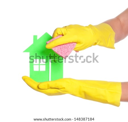 Paper house on woman hands in gloves over white background - stock photo