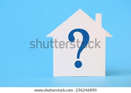 Paper house with question mark on blue background - stock photo