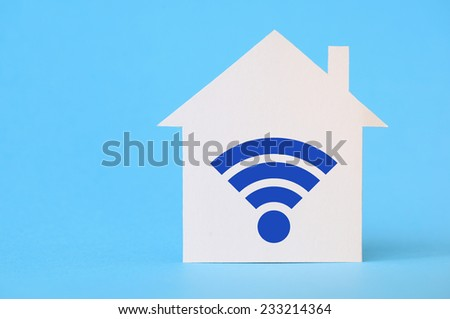 Paper house with wi-fi symbol - stock photo