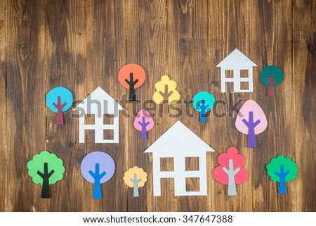 Paper houses and trees, home green environment - stock photo